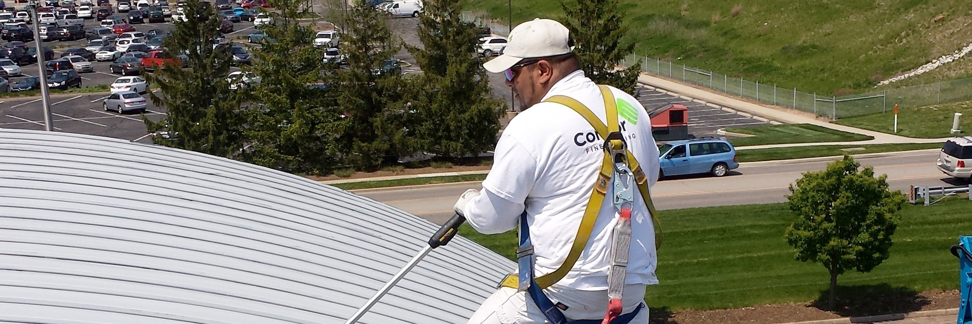 Applying epoxy mastic primer to commercial rooftop in Indianapolis, Indiana.