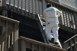 CFP Employee painting a railing