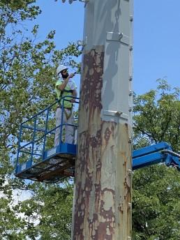 CFP Employee Painting the IPL Pole